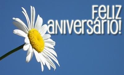 Blume zum Geburtstag mit portugiesischer Gratulation